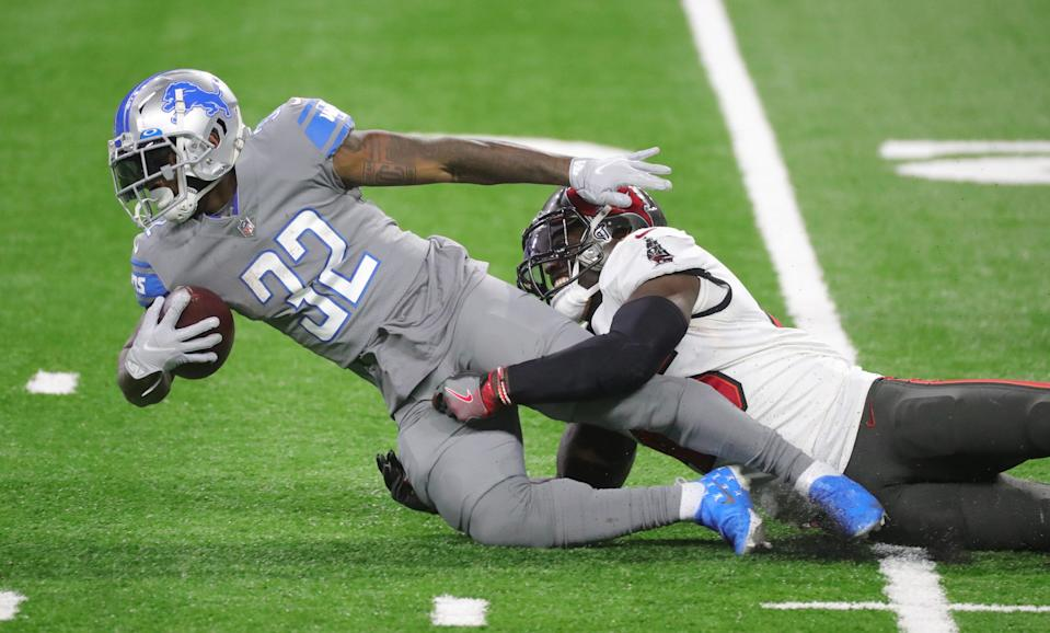 Detroit Lions running back D'Andre Swift is tackled by Tampa Bay Buccaneers linebacker Devin White during the second half Saturday, Dec. 26, 2020 at Ford Field.