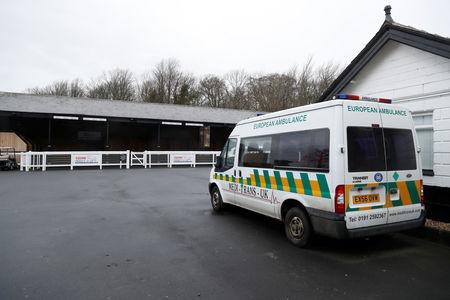 Horse Racing - Newcastle - Newcastle Racecourse, Newcastle upon Tyne, Britain - February 8, 2019   General view of an ambulance next to the stables at the racecourse after the meeting is cancelled following the confirmed outbreak of equine flu   Action Images via Reuters/Lee Smith