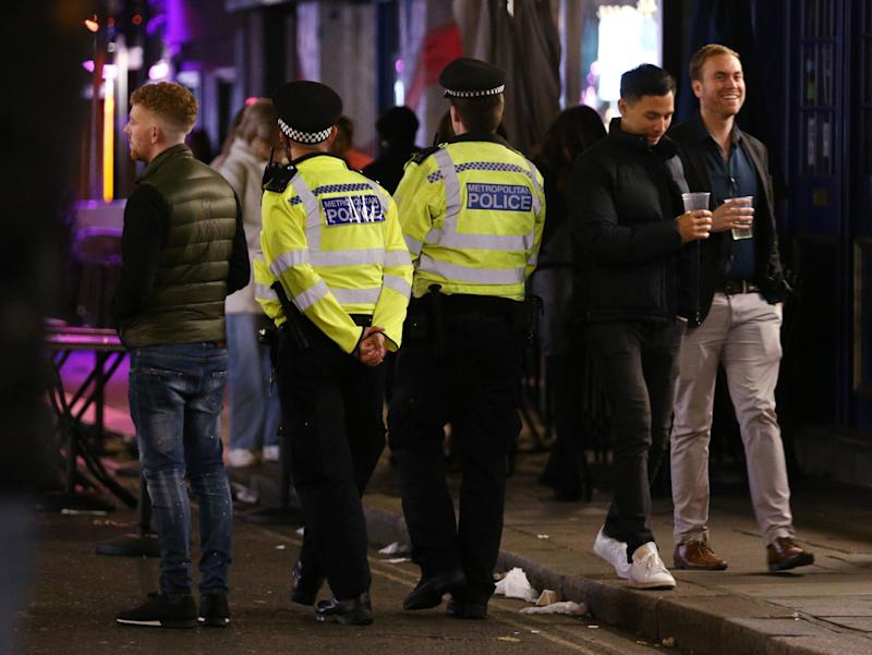 Police officers on patrol ahead of closing time in Soho, London, after pubs and restaurants were subject to a 10pm curfew to combat the rise in coronavirus cases in England. (Yui Mok/PA Wire)