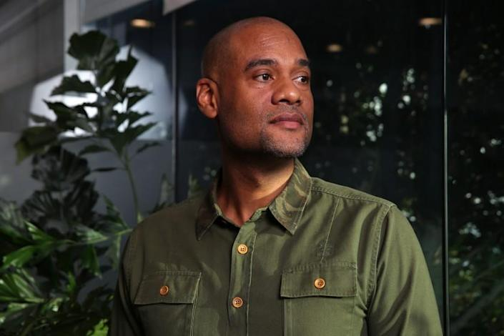 """4thMVMT CEO Karim Webb poses for a portrait at his offices on November 22, 2019, in Los Angeles. The firm trains and finances people from communities hit hardest by the war on drugs, preparing them to open cannabis businesses in the newly legal industry. <span class=""""copyright"""">(Dania Maxwell / Los Angeles Times)</span>"""