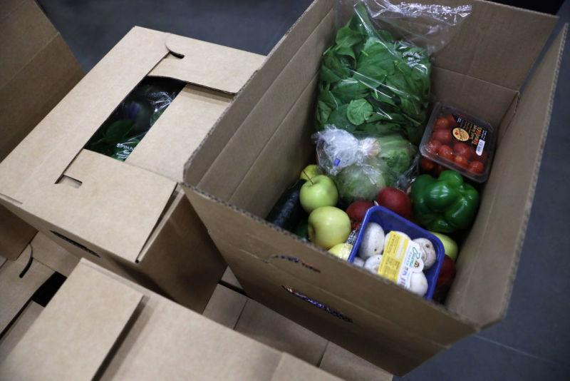 Content of a food box is seen during a tour at the distribution center of Coastal Sunbelt Produce May 15, 2020 in Laurel, Maryland.