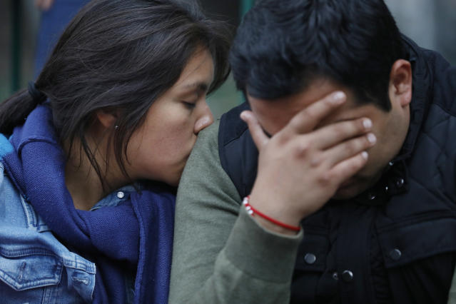 <p>Alejandra Reynoso, left, and boyfriend Alejandro Gamez, wait for news on Gamez's sister Karen Nayeli, 25, who is missing from a collapsed office building along Calle Alvaro Obregon, in Colonia Condesa, in Mexico City, on Sept. 20, 2017. (Photo: Gary Coronado/Los Angeles Times via Getty Images) </p>