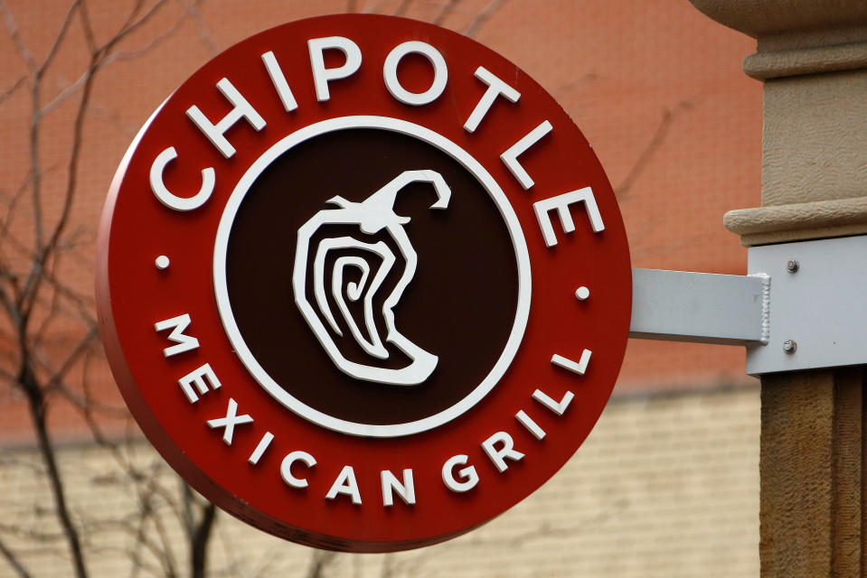 FILE- This Jan. 12, 2017, file photo shows the sign on a Chipotle restaurant in Pittsburgh.  Chipotle is moving its headquarters from its hometown of Denver to southern California, the burrito chain announced Wednesday, May 23, 2018. (AP Photo/Gene J. Puskar, File)