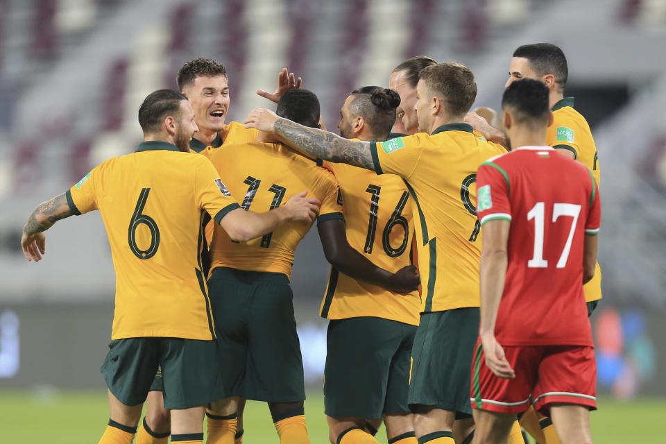 Australia's players celebrates their opening goal during a FIFA World Cup group B qualifying soccer match between Australia and Oman in Doha, Qatar, Thursday, Oct. 7, 2021. (AP Photo/Hussein Sayed)