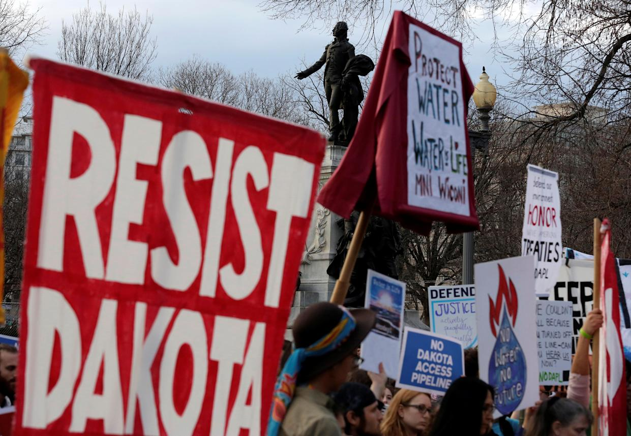 People protest at the White House against President Donald Trump's directive to permit the Dakota Access Pipeline project to move forward in February 2017. (Joshua Roberts / Reuters)