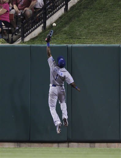 Kansas City Royals center fielder Jarrod Dyson (1) misplays the bounce off the wall on a double by St. Louis Cardinals' Matt Adams, allowing David Freese to score from first, in the seventh inning of a baseball game, Friday, June 15, 2012 in St. Louis.(AP Photo/Tom Gannam)