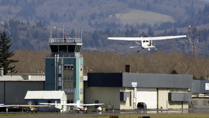 FILE - In this March 7, 2013 file photo, a small plane takes off past the control tower at Troutdale Airport in Troutdale, Ore. Starting this weekend, control towers at scores of small airports are to begin shutting down because of government-wide automatic spending cuts. But federal officials insist the closures won't compromise safety, and there's evidence that some of the closures may even make economic sense. (AP Photo/Don Ryan)