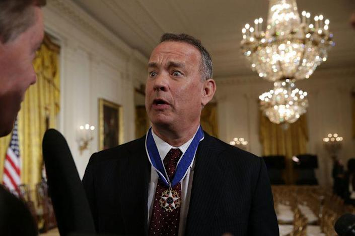 Hanks speaks to members of the media after receiving the Presidential Medal of Freedom at the White House, Nov. 22, 2016. (Alex Wong/Getty Images)