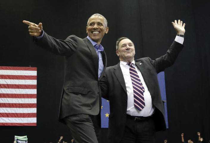 CORRECTS TO SAY THAT DONNELLY IS A CONGRESSIONAL CANDIDATE, NOT A GUBERNATORIAL CANDIDATE - Former President Barack Obama, left, points as Democratic congressional candidate U.S. Sen. Joe Donnelly waves to the crowd during a campaign rally at Genesis Convention Center in Gary, Ind., Sunday, Nov. 4, 2018. (AP Photo/Nam Y. Huh)