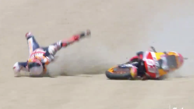 A screenshot shows MotoGP champion Marc Marquez bouncing across the gravel trap after he was thrown from his bike.