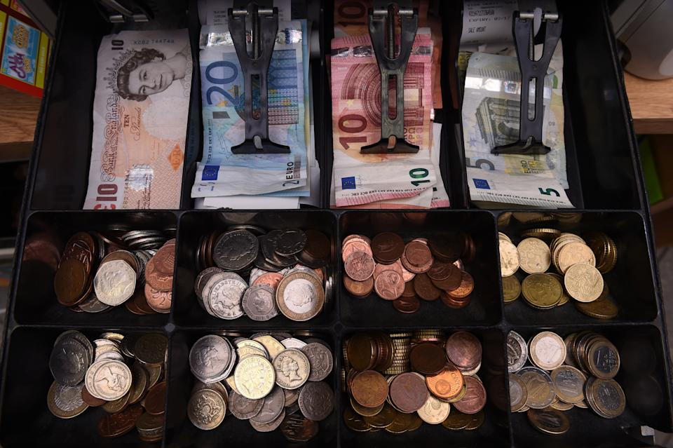 A shop cash register is seen with both Sterling and Euro currency in the till at the border town of Pettigo, Ireland October 14, 2016. REUTERS/Clodagh Kilcoyne