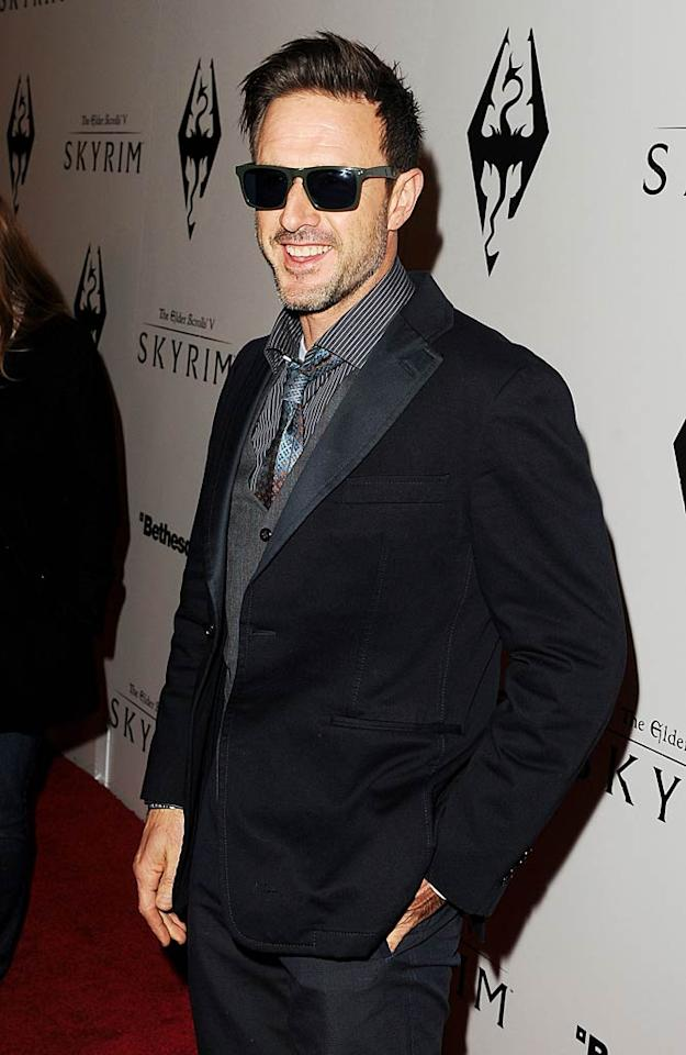 """Meanwhile, David Arquette played it cool in shades during what must be a tumultuous time for him personally. Earlier in the day, the actor admitted to Howard Stern that he and his estranged wife, Courtney Cox, would not be getting back together, and that he's in love with his new girlfriend, """"Entertainment Tonight"""" reporter Christina McLarty. (11/8/2011)"""