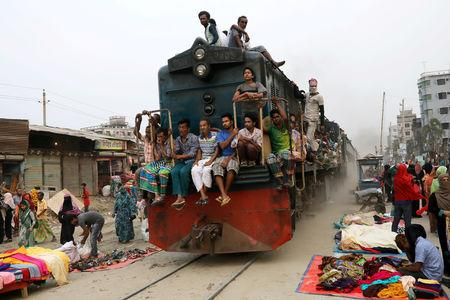 FILE PHOTO: Passengers travel on an overcrowded train in Dhaka, Bangladesh, October 8, 2018. REUTERS/Mohammad Ponir Hossain/File Photo
