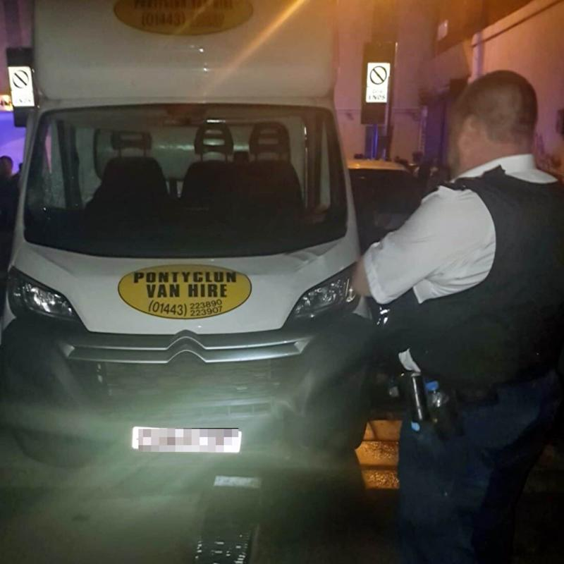Police guard the van used in the mosque attack - Credit: @999London/Caters News