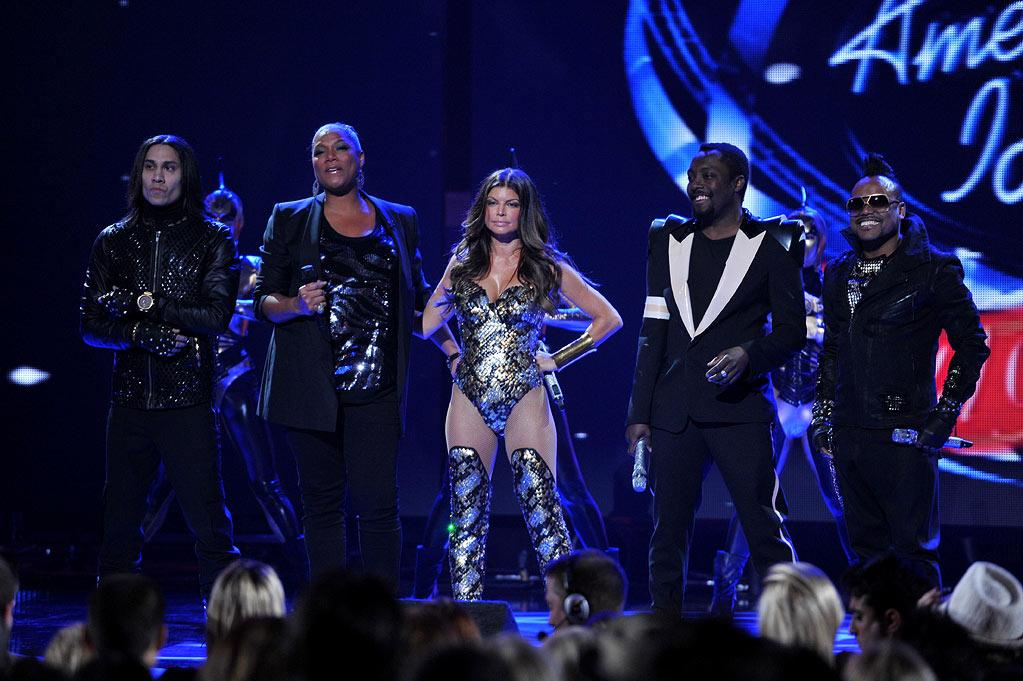 """Queen Latifah with The Black Eyed Peas on <a href=""""/american-idol/show/34934"""">""""Idol Gives Back.""""</a>"""