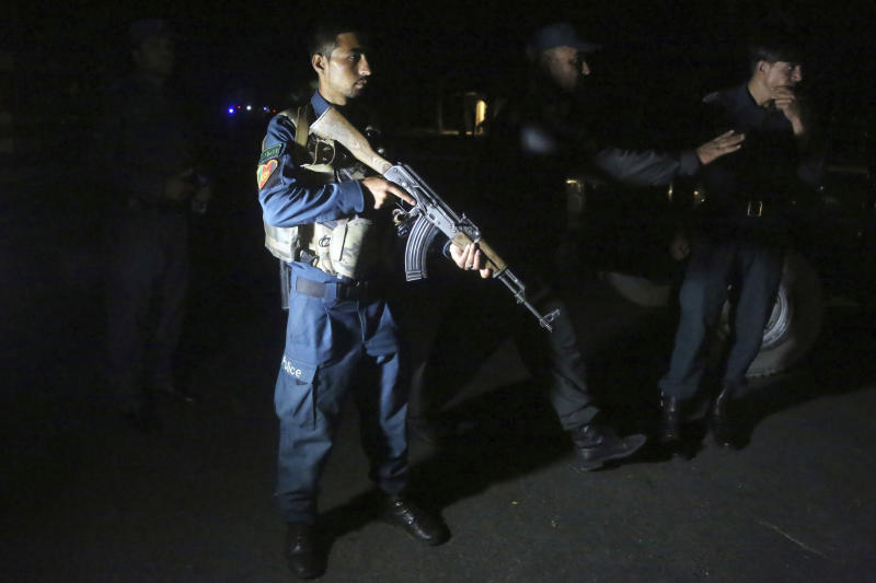 Afghan police arrive at the site of a bombing in a mosque in Kabul, Afghanistan, Tuesday, June 2, 2020. Tariq Arian, spokesman for the Afghan interior ministry says the the attack has taken place inside the compound of Wazir Akber Khan Mosque on the Tuesday evening. (AP Photo/Rahmat Gul)