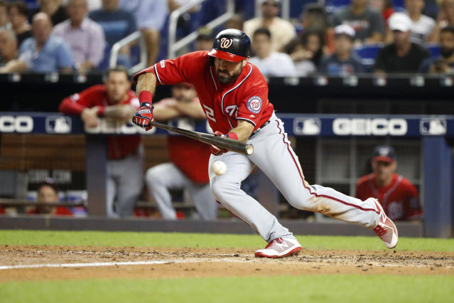 Washington Nationals' Adam Eaton bunts during the fifth inning of a baseball game against the Miami Marlins, Saturday, Sept. 21, 2019, in Miami. (AP Photo/Wilfredo Lee)