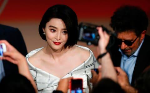 Fan Bing Bing poses for photos at the Cannes Film Festival in 2017 - Credit: LAURENT EMMANUEL/AFP/Getty Images