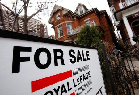 FILE PHOTO: A house is seen for sale on the real estate market in Toronto