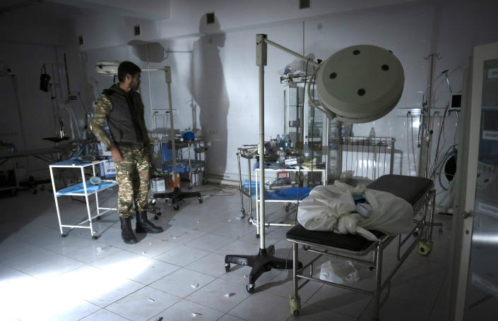 The doctor of a local hospital, damaged by shelling from Azerbaijan's artillery, stands in the surgery room of his hospital in the town of Martakert, during a military conflict, the separatist region of Nagorno-Karabakh, Thursday, Oct. 15, 2020. The conflict between Armenia and Azerbaijan is escalating, with both sides exchanging accusations and claims of attacks over the separatist territory of Nagorno-Karabakh.(AP Photo)