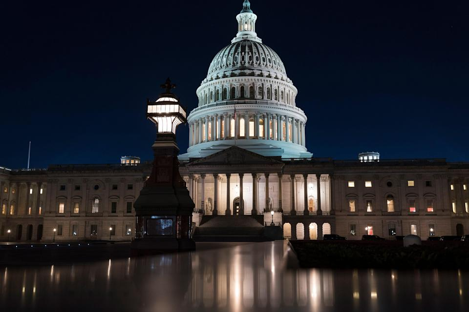 The Capitol is seen at dusk Friday during an impasse in negotiations on President Joe Biden's $1.9 trillion COVID-19 relief bill.