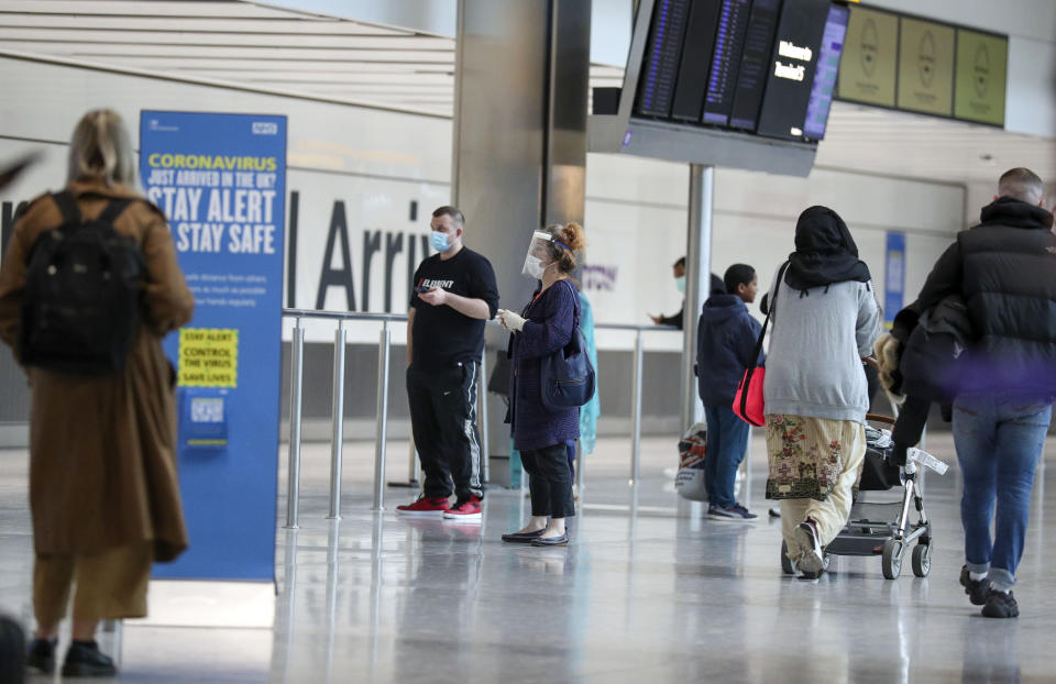 Passengers at Heathrow Airport's Terminal 5, after people returning from Spain were told they must quarantine when they return home.