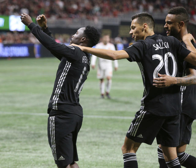 Sporting Kansas City forward Gerso Fernandes, left, celebrates with Daniel Salloi, who scored earlier, during the second half of an MLS soccer match against Atlanta United on Wednesday, May 9, 2018, in Atlanta. (Curtis Compton/Atlanta Journal-Constitution via AP)