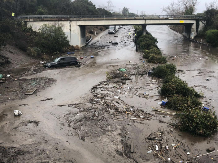 <p>U.S. Highway 101 at the Olive Mill Road overpass is flooded with runoff water from Montecito Creek in Montecito, Calif. on Tuesday, Jan. 9, 2018. (Photo: Mike Eliason/Santa Barbara County Fire Department via AP) </p>