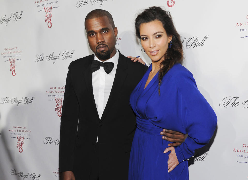 FILE - Kanye West, left, and Kim Kardashian attend Gabrielle's Angel Foundation Angel Ball cancer research benefit on Oct. 22, 2012, in New York. Kim Kardashian West filed for divorce Friday, Feb. 19, 2021, from Kanye West after 6 1/2 years of marriage. Sources familiar with the filing but not authorized to speak publicly confirmed that Kardashian filed for divorce in Los Angeles Superior Court. The filing was not immediately available. (Photo by Evan Agostini/Invision/AP, File
