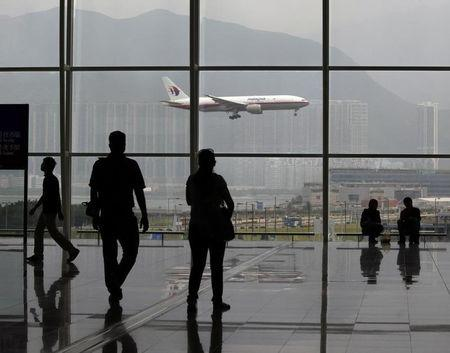 A Malaysia Airlines Boeing 777 plane is seen from the departure hall at the Hong Kong International Airport