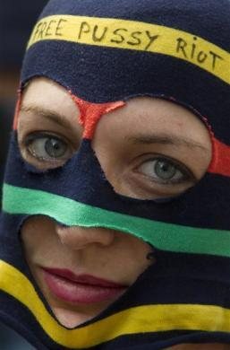 A woman wearing a trademark Pussy Riot balaclava attends a support rally for the detained members of the Moscow based feminist punk band outside the Russian embassy in Berlin, August 17, 2012.