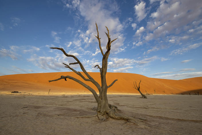 """Sossusvlei is a salt and clay pan surrounded by high red dunes in the southern part of the Namib Desert, in Namib-Naukluft National Park. The name """"Sossusvlei"""" is often used to refer to the surrounding area, one of Namibia's major visitor attractions. (Photo: Gordon Donovan/Yahoo News)"""