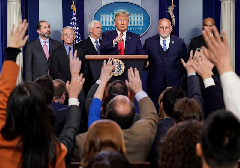 U.S. President Donald Trump takes questions ftom the audience during a news conference on the coronavirus outbreak with U.S. Secretary of Health and Human Services Alex Azar, National Institute of Allergy and Infectious Diseases Anthony Fauci, U.S. Vice President Mike Pence, Director of the Centers for Disease Control and Prevention Robert Redfield and U.S. Surgeon General Jerome Adams at the White House in Washington, U.S., February 29, 2020. REUTERS/Joshua Roberts