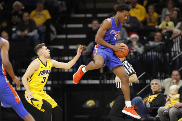 Savannah State guard Jaquan Dotson saves the ball from going out of bounds in front of Iowa guard Jordan Bohannon, left, during the first half of an NCAA college basketball game, Saturday, Dec. 22, 2018, in Iowa City, Iowa.(AP Photo/Charlie Neibergall)