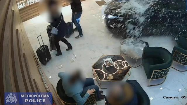 A gang of armed robbers used a luxury Range Rover to smash their way into a jewellery shop in Shepherd's Bush, west London, before members of the public stopped one of them from running away (SWNS)