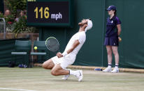 Sebastian Korda of the US plays a return during the men's singles fourth round match against Russia's Karen Khachanov on day seven of the Wimbledon Tennis Championships in London, Monday, July 5, 2021. (Peter Nicholls/Pool via AP)