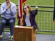 Oregon Governor Kate Brown pumps her fist while announcing the end of the state's COVID-19 restrictions in Portland, Ore., Wednesday, June 30, 2021. (AP Photo/Craig Mitchelldyer)
