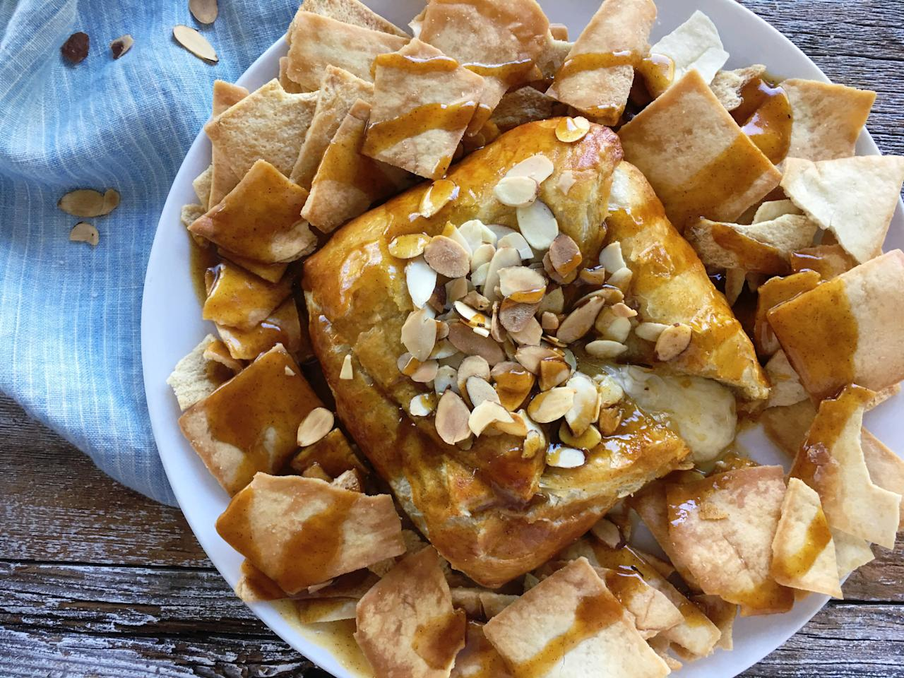 """<p>Your friends will be astonished at the ease and delight that baked brie brings to the table before dinner is served. It's the perfect mix of sweet and salty with benefit of a warm, gooey inside and a crispy, flaky crust on the outside. Store-bought puff pastry wraps around the entire wheel of brie, and it's finished with a drizzle of the pumpkin-spiced maple sauce that's decadent and sweetened with maple syrup. With a sprinkle of a few sliced almonds for a crunchy texture and a rich, nutty flavor, this starter is ideal menu item to any fall themed meal.</p> <p><a href=""""https://www.myrecipes.com/recipe/baked-brie-with-pumpkin-maple-sauce"""">Baked Brie with Pumpkin Maple Sauce&nbsp; Recipe</a></p>"""