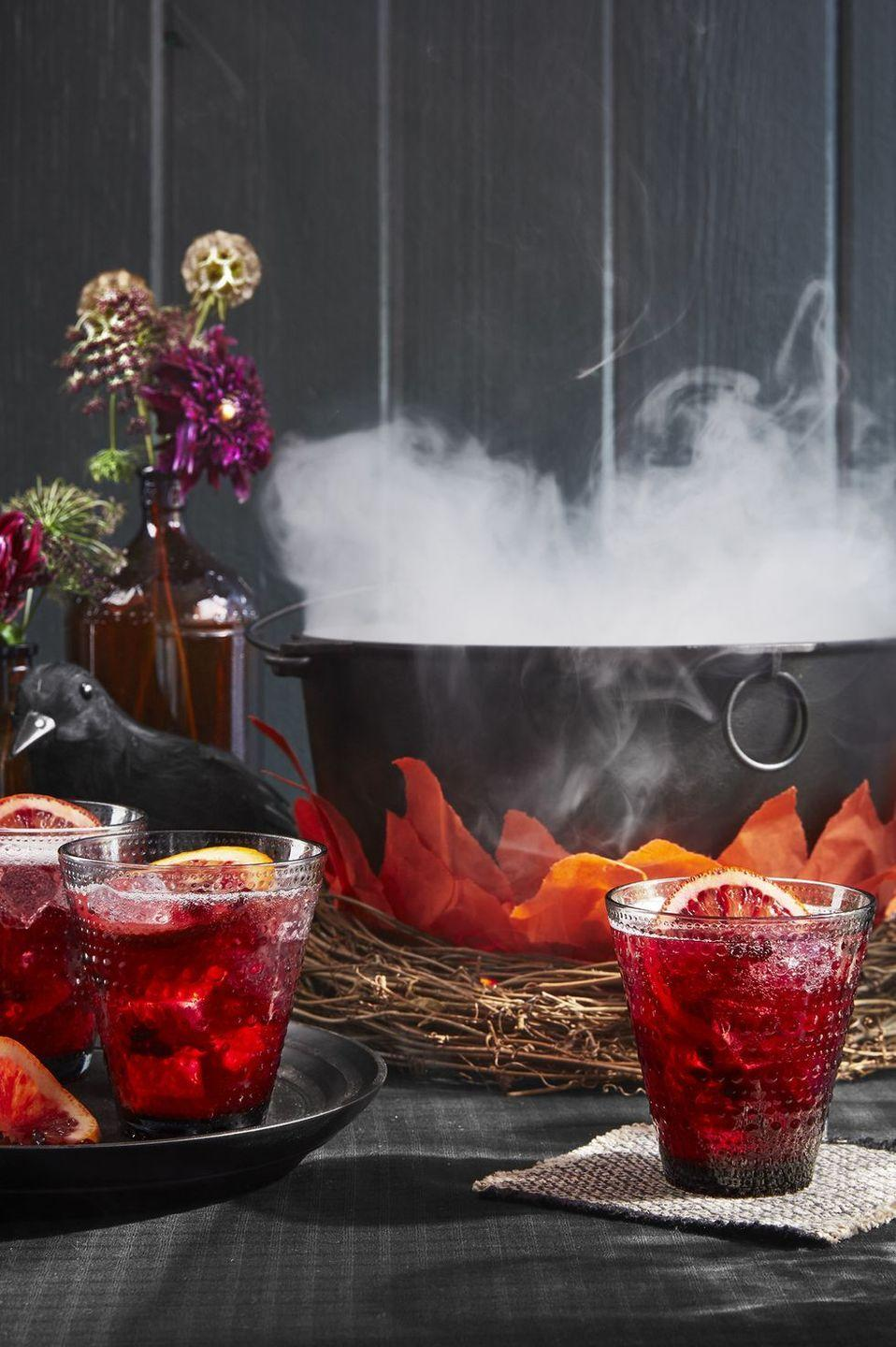 """<p>Serve your party punch in this as-real-as-it-gets cauldron. Stick the cauldron inside a grapevine wreath, and then dress the sides with paper flames. Throw some dry ice inside for a smokey effect, and then see how many people dare try what's inside.</p><p><a class=""""link rapid-noclick-resp"""" href=""""https://www.amazon.com/GIFTEXPRESS-Black-Cauldron-MADE-USA/dp/B01256VXNO/?tag=syn-yahoo-20&ascsubtag=%5Bartid%7C10055.g.421%5Bsrc%7Cyahoo-us"""" rel=""""nofollow noopener"""" target=""""_blank"""" data-ylk=""""slk:SHOP CAULDRONS"""">SHOP CAULDRONS</a></p>"""