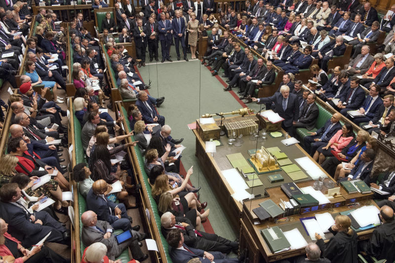 In this handout photo provided by the House of Commons, Britain's Prime Minister Boris Johnson, center right, gestures during his first Prime Minister's Questions, in the House of Commons in London, Wednesday, Sept. 4, 2019. Britain's Parliament is facing a second straight day of political turmoil as lawmakers fought Prime Minister Boris Johnson's plan to deliver Brexit in less than two months, come what may. Johnson is threatening to dissolve the House of Commons and hold a national election that he hopes might produce a less fractious crop of legislators. (Jessica Taylor/House of Commons via AP)