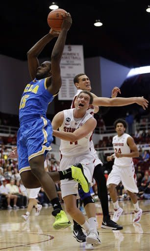UCLA's Shabazz Muhammad, right, grabs a high pass next to Stanford's Andy Brown, center, and Dwight Powell, right, during the first half of an NCAA college basketball game in Stanford, Calif., Saturday, Feb. 16, 2013. (AP Photo/Marcio Jose Sanchez)