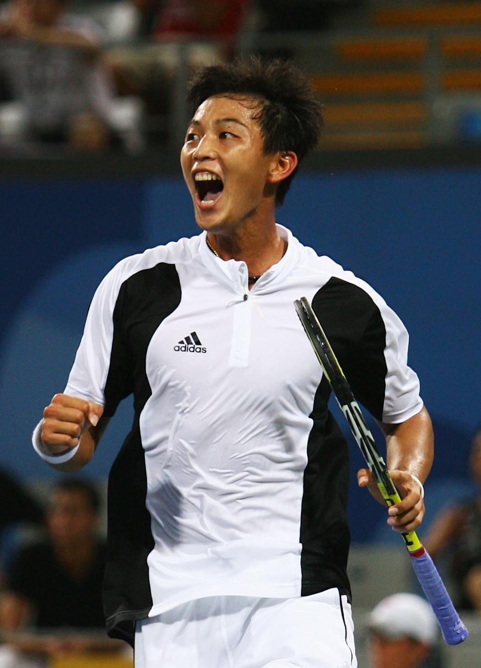BEIJING - AUGUST 11:  Lu Yen-Hsun of Chinese Taipei celebrates winning match point against Andy Murray of Great Britain in the Men's Singles First Round match at the Olympic Green Tennis Center on Day 3 of the Beijing 2008 Olympic Games on August 11, 2008 in Beijing, China.  (Photo by Julian Finney/Getty Images)
