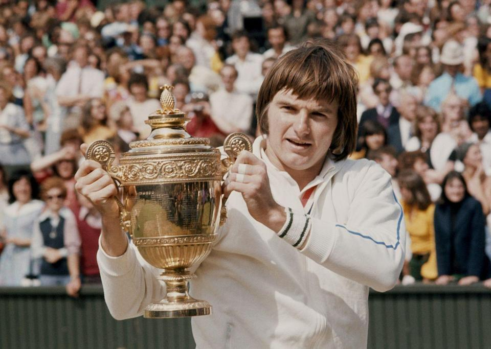 <p>Jimmy Connors holds the trophy after winning the Men's Singles Final match against Ken Rosewall in July 1974.</p>