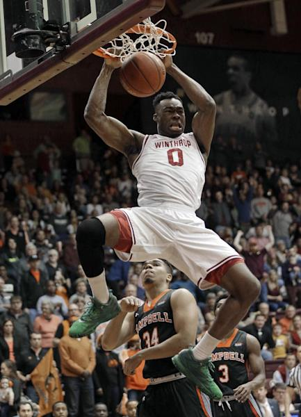 Winthrop's Duby Okeke (0) dunks past Campbell's Marcus Burk (34) in the first half of the Big South Conference championship NCAA college basketball game in Rock Hill, S.C., Sunday, March 5, 2017. (AP Photo/Chuck Burton)