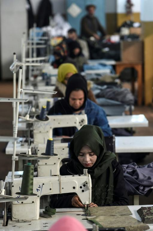 Around 120 women are employed in Kabul by the defence ministry to make uniforms for servicemen and prisoners