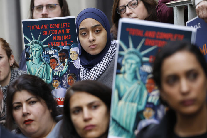 FILE - In this Jan 28, 2020, file photo, demonstrators listen to speakers during a rally outside the U.S. 4th Circuit Court of Appeals in Richmond, Va. President Trump appears to be ignoring a deadline to establish how many refugees will be allowed into the United States in 2021, raising uncertainty about the future of the 40-year-old resettlement program. The 1980 Refugee Act requires presidents to issue their determination before Oct. 1, 2020, the start of the fiscal year. (AP Photo/Steve Helber, File)