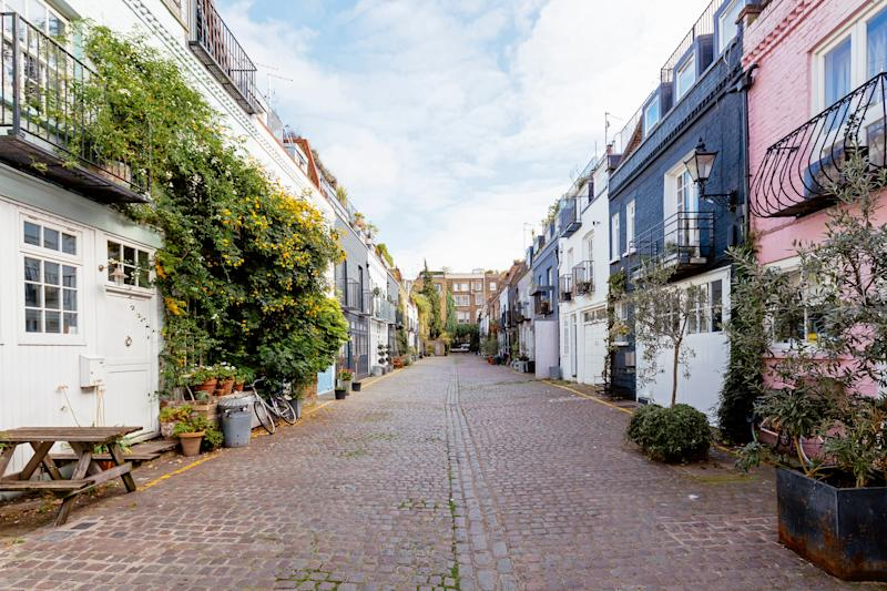 Mews houses along cobbled street in Notting Hill, London, England, UK. Photo: Getty