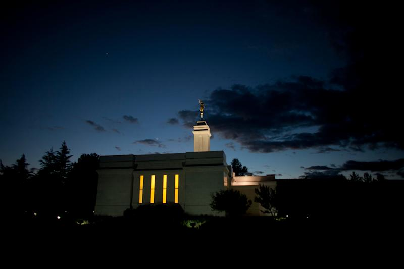 The Mormon temple is lit as night falls in Colonia Juarez, in Mexico's Chihuahua state, Tuesday, Jan. 24, 2012. Several descendants of U.S. Republican presidential candidate Mitt Romney's grandfather's brother live in this town.(AP Photo/Dario Lopez-Mills)