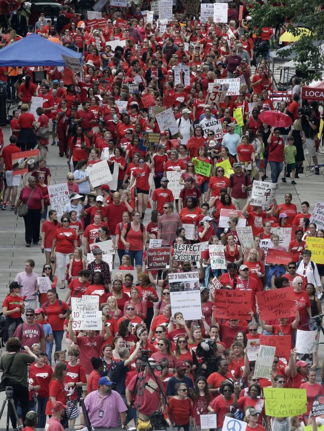 <p>Participants make their way towards the Legislative Building during a teachers rally at the General Assembly in Raleigh, N.C., Wednesday, May 16, 2018. (Photo: Gerry Broome/AP) </p>