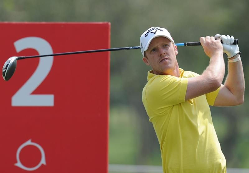 David Horsey of England tees off during the Avantha Masters golf tournament in Greater Noida, on the outskirts of New Delhi, on March 14, 2013